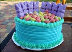 Peeps cake with purple blue reds and greens