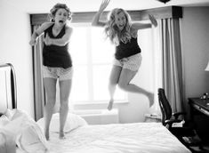Maid of Honor & Bride jumping on the bed the day of the wedding!