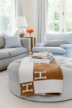 A gray sofa topped with blue pillows complements blue chairs topped with gray pi. A gray sofa topped with blue pillows complements blue chairs topped with gray pillows in this beautiful gray and blue li. Ottoman In Living Room, Living Room Chairs, Living Room Furniture, Living Room Decor, Bedroom Decor, Living Rooms, Grey Pillows, Gray Sofa, Ottoman Decor