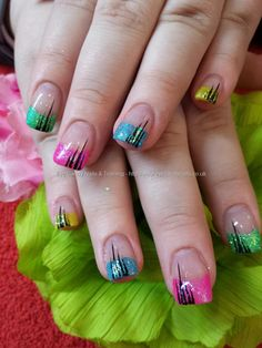 Multi coloured glitter tips over acrylic nails