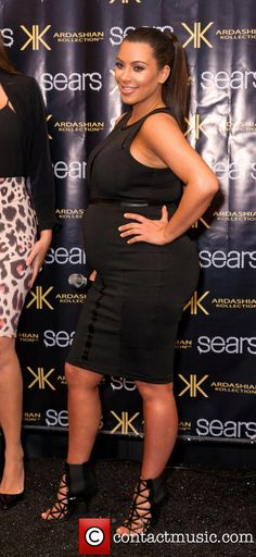 A Heavily pregnant Kim Kardashian in May 2013 #BabyBump