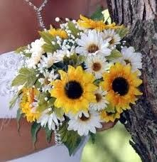 sunflowers and daises. My two favorite flowers. I like that the bouquet isn't just sunflowers. The daises match well.