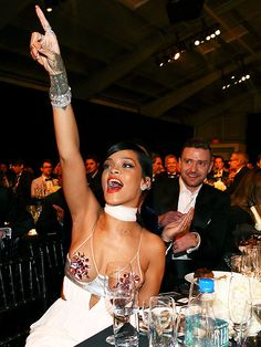 Star Tracks: Thursday, October 30, 2014 | LOUD & CLEAR | She's the one! Rihanna sounds off Wednesday night during the live auction portion of the Fiji Water-sponsored amfAR Inspiration Gala in Los Angeles as an amused Justin Timberlake looks on.
