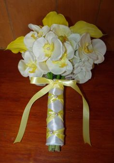 Brides Calla lilly and orchid bouquet at www.silkweddingflowersforless.com Just $50.00.