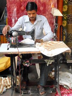 I would love to get an old fashioned foot pedal sewing machine, The Village Tailor