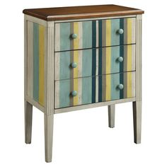 Wood chest with multicolor striping and fluted detail.    Product: ChestConstruction Material: WoodC...