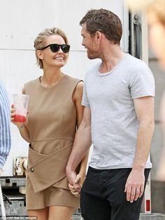 Loved up: It seems Lara Worthington (nee Bingle) is as smitten with husband Sam Worthington as ever with the pair looking delightfully happy while walking around New York on Thursday