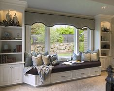 Large window seat...build into room next to kitchen with built-in shelves around the seat, maybe desk area attached & still room for small, white table