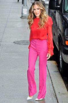 Parker gives a lesson in color-blocking in a bright red Prabal Gurung blouse and pink wool pants.