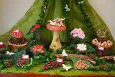 Enchanted Forrest.This birthday party was truly magical. The dessert table was set up as a enchanted forest using real wood stumps & logs, green moss & fresh berries. The table featured a central mushroom with fairy sitting on top. It included magic mushroom cookies, butterfly cookies, magic pink marshmallow mushrooms, candy forest berries, chocolate berry cups, chocolate forest logs & fairy floss. Each guest also received a hessian bag filled with berry candy as well as a  chocolate bar.