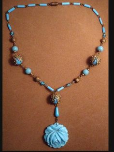 This is an early art deco all glass necklace with a large glass turquoise color floral drop. The long slender beads are also glass and if you know anything about Czech glass, they are very hard to find...