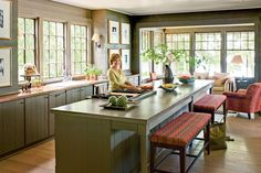 Natural Lake House Kitchen - 110 Beautiful Kitchens - Southernliving. Dark, woodsy hues, such as the bark brown stain on interior walls and trim and driftwood gray on the cabinetry, set the mood. Well-chosen accents of red, chartreuse, and turquoise stand out from the subdued backdrop without interrupting the calm.  See more of this Natural Georgia Lake House