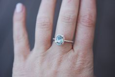 Rose Gold Engagement ring by Eidelprecious. The ring features a 1.55ct cushion Aqua green blue sapphire. The stone is unbelievable - natural