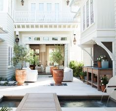 "Any outdoor room is nice, but a courtyard scores extra points. ""It's an exterior space that's cozy and private,"" says Atlanta architect Timothy Adams, whose patio design in Watercolor, Florida, is surrounded by the house."