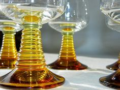 Vintage 1960s Modern Amber Bockling Cordials by BonAppetitAntique, $50.00. These are really different then most glasses from this age. I like them.