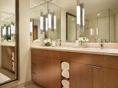 Here are some tips for creating a bathroom that looks bigger than it really is.: Use large mirrors