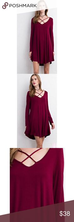 5⭐️ Burgundy Crisscross Strap Trapeze Dress Semi-loose fit, longsleeve, V Neck with Crisscross Straps Across Chest, Tunic dress. Scoop V-back with strap across shoulder. This tunic dress is made with heavy weight, knit jersey that is very soft, drapes well and has great stretch. Available in Olive, Burgundy & Black.  Material: 95%Rayon 5%Spandex  No Trades. Price is firm unless bundled. 10% off 2 or more items or 15% 3 or more items. GlamVault Dresses