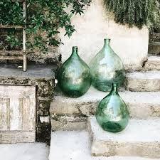 Green glass bottles for the garden – rustic home exterior Round Glass Vase, Green Glass Bottles, Wine Bottles, Glass Jars, Garden Inspiration, Outdoor Spaces, Backyard, Rustic, Home Decor