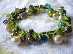 Crochet with beads around elastic bands - tutorial.  Directions not in English, but pictures are good.