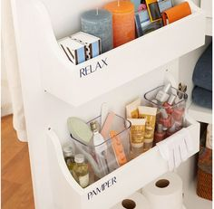 Organize bathroom cabinet -- with spice racks!