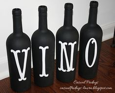 Casual Fridays: Wine Bottles - spray painted wine bottles with vinyl cut letters to add as decor to my wine themed kitchen :)