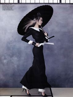 It might actually be 'parasol love' but this photo is fierce as hell. Vogue Korea: 'Martial Arts' | Tom & Lorenzo