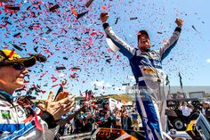 Oswaldo Negri Jr. , R, celebrates with co-driver John Pew, L, after winning the IMSA WeatherTech Series race at Mazda Raceway Laguna Seca on May 1, 2016 in Monterey, California.