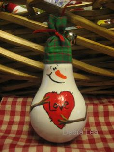 Items similar to Hand Painted Christmas Snowman Love Lightbulb Light Bulb Ornament OOAK HP on Etsy Christmas Ornament Crafts, Christmas Snowman, Christmas Projects, Holiday Crafts, Christmas Decorations, Santa Ornaments, Light Bulb Art, Light Bulb Crafts, Painted Light Bulbs