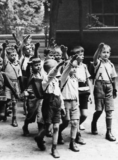 Children exit school with the 'Hitlergruß'. Germany, 1933. Unattributed