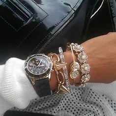 J'adore la mode/ love the first bracelet on her wrist.