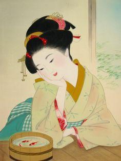 望着金鱼的艺妓 A woman dressed in kimono
