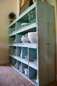 love the color of the shelves with white kitchenware.. couldn't keep down low because of kids but could hang on wall