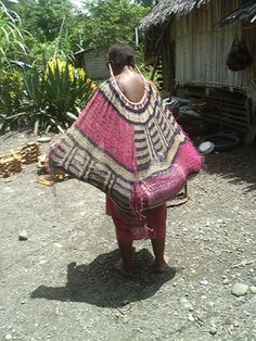 Papua New Guinea--Bilum bag with child inside. Bag is suspended from forehead.