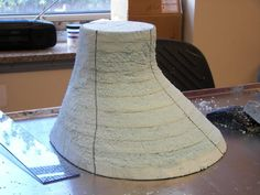 The making of a hat block from foam board. (This stuff would work great for making various displays.)
