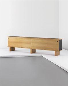 Charlotte Perriand; Oak, Painted Metal and Plastic 'Bahut' Sideboard, c1960.