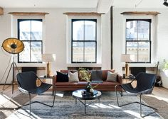 Peeling back the layers on an early century SoHo loft in New York City took time, patience, and some creative problem-solving for the interior design team behind Becky Shea Design. Soho Loft, New York Loft, Living Room Colors, Living Room Designs, Living Spaces, Loft Spaces, City Living, Living Rooms, Interior Exterior