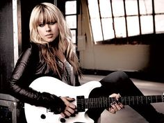 Orianthi; she is said to be one of the top twelve female guitarists today by Elle magazine and she plays for Alice Cooper. Mind = blown