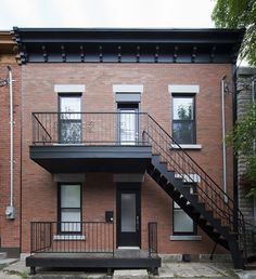 "At the city's request, the design at the front of the home did not receive a major change—which included keeping the duplex's stairs. ""Everything is restored, but in a way that is respectful,"" Blouin said. Building Renovation, Building Facade, Brick Facade, Facade House, Montreal Architecture, Duplex Design, House Paint Color Combination, Exterior Paint Colors For House, 3d Home"