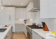 """The kitchen in this modern Boston condo was designed byDavidfrom ourBraintree showroom,in collaboration with the project's developer: HRV Homes. The design features high-gloss, flat-panel cabinetry from our full-access line: ShowplaceEVO, beautiful quartz countertops with a waterfall edge, an integratedrefrigerator, and specialty hardware to complement the """"clean lines"""" look of the design. Cabinets:ShowplaceEVO Duet Finish:High Gloss [...]"""