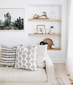 New Bohemian style living room interior design with a neutral color palette and African mudcloth style throw pillows #home #style