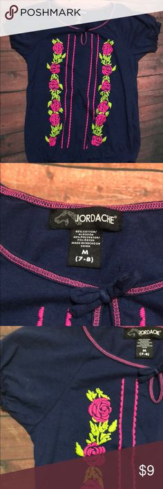 Girls Size 7-8 Jordache Embroidered Top Girls Size 7-8 Jordache Embroidered Top So Cute to wear with jeans or a skirt.  Navy blue with bright hot pink flowers. 🌸  Not just another tee, but very classy! A great staple for your little one's posh closet! Shirts & Tops