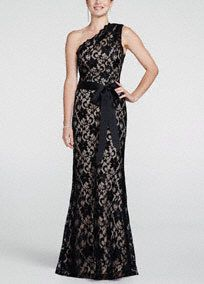 Beautifully elegant and sophisticated, you will look and feel like a million in this breathtaking lace dress!  One shoulder bodice features all over stunning and ultra-feminine lace detail.  Satin ribbon at waist helps create a flattering silhouette and eye-catching accent.  Fully lined. Side zip. Imported nylon/spandex blend. Professional spot clean.