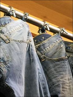 No, I can't imagine the use of Muffler Clamp Jean Hang Merchandising is to appeal to a Moterhead demographic. I suspect the U-Clamp is to keep the samples