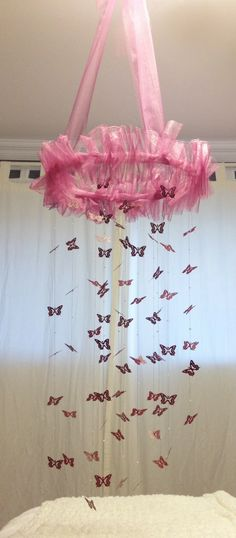 Dark Pink butterfly & Pearl Decorative Mobile.  Tulle ruffle and bow, pearl beads between each butterfly.  Roughly 4 feet long.
