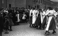 War Dance, 1919  East London residents dance at a street party to mark the end of the First World War. Zeppelins had caused major damage to the area during the War with their indiscriminate bombing claiming many civilian lives.