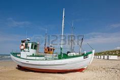 a photo of fishing boats at the beach (Denmark) photo