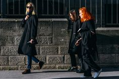 I love how legendary editors Tonne Goodman, Phyllis Posnick, and Grace Coddington aren't wearing anything attention-grabbing. It's their signature uniform of all-black, casual shoes, and their familiar hairdos that make a statement. Photo: Tommy Ton