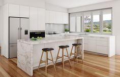 Light polyurethane doors, timber floors, and marble benchtop combine well in this design.