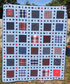 This is the quilt I made for my Mom from my Dad's shirts.  Again, I used the Slide Show pattern.  It's a perfect pattern for a memory quilt.