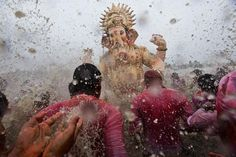 India Indian Hindu devotees splash water on a large statue of the elephant-headed Hindu God Ganesha before immersing it in the Arabian Sea on the final day of the festival of Ganesha Chaturthi in Mumbai, India, Sept. 8, 2014.  CREDIT: Bernat Armangue/AP